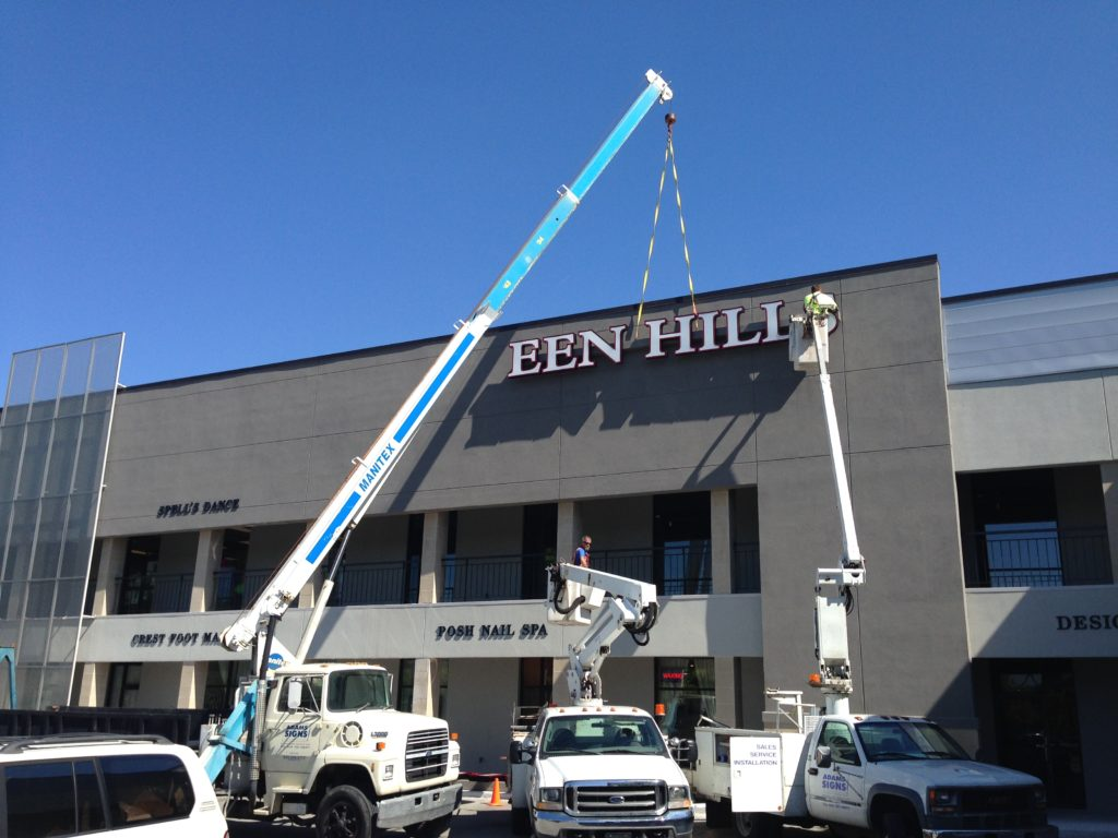 Gallery At Green Hills installation in progress by Adams Signs & Awnings